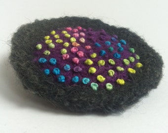 100s & 1000s: a large colourful embroidered felt brooch