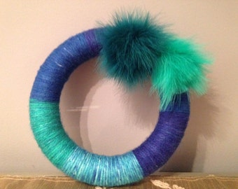 Shades of blue yarn with 2 pom pom feathers    ~made to order~