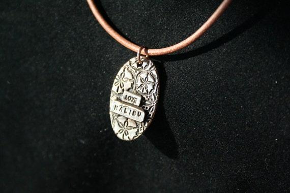 Sand Dollars with Love Malibu -- Bronze pendant with sand dollar background saying love malibu