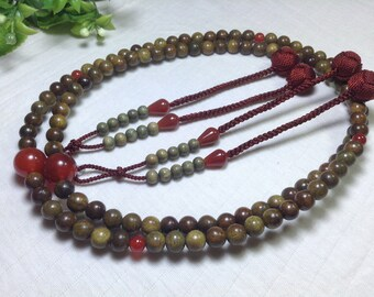 Juzu 108 malas,green sandalwood carved,red carnelian parent beads,with tassels of red woven balls