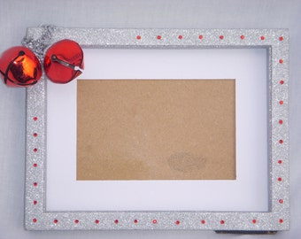 Red and silver shadow box picture frame. 3.5 x 5.5 picture and 6 3/4 x 8 3/4 frame.