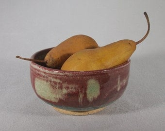 Small red and green stoneware ceramic bowl