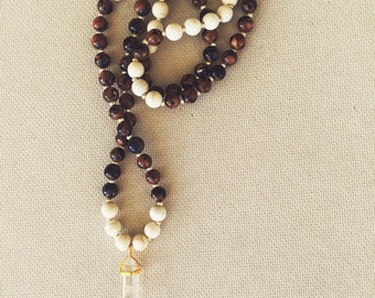 Black, amber, and white beaded long necklace with crystal