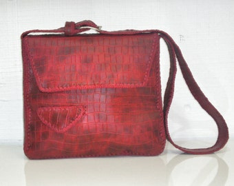 Red crocodile bag