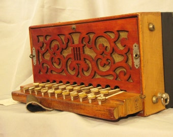 Restored 1920's Hohner B/E bronze reed melodion accordion