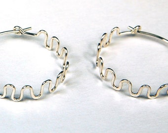 whoops! silver hoop earrings...Squiggle sterling silver hoop earrings, hammered sterling silver