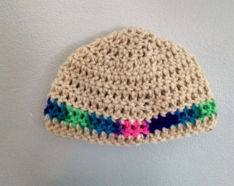 a size 0-3 month crocheted baby hat, with a cute splashes of color in the stripe