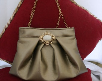 One of a kind, hand made, champagne colored, leather clutch.
