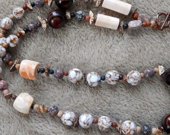04-20-32. Beaded necklace with ceramic, wood, seed, and bone beads..