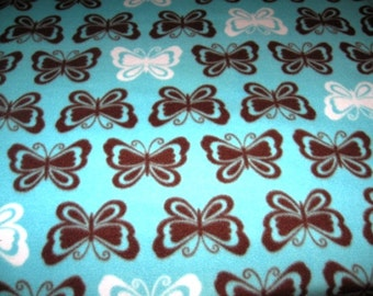 Brown and white butterfly on turquoise fleece adult blanket