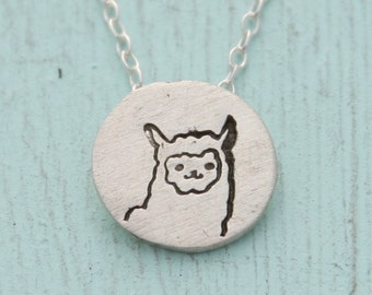 tiny LLAMA circle necklace, illustration by BOYGIRLPARTY, eco-friendly silver.  Handcrafted by Chocolate and Steel.