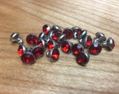 7mm Red synthetic crystal rivets 10/pk