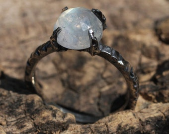 Moonstone cut signet style ring in brushed and oxidized sterling silver textured band