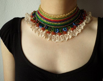 beaded crochet collar necklace with red, golden yellow, blue and chartreuse green seed beads and crocheted lace