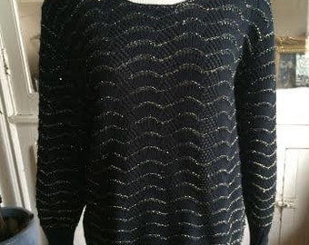 Vintage 1980's black and gold sweater. womens size M/L