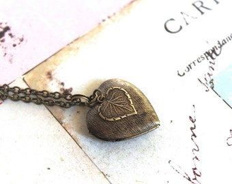 leaf. heart locket necklace. in brass ox with etched lines locket
