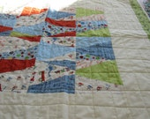 Improvizationally Pieced Boys Crib Quilt with Scoot Fabric designed by Riley Blake
