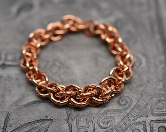 Bronze graduated jens pind spiral braided chainmaille ring