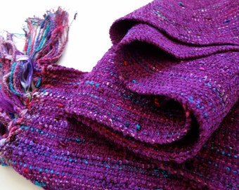 Handwoven scarf in magenta on beautiful berry background