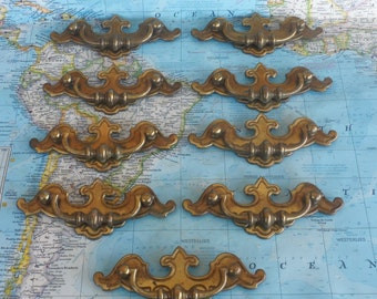 SALE! 9 vintage curved distressed brass metal pull handles