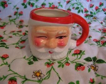 charming miniature winking santa mug