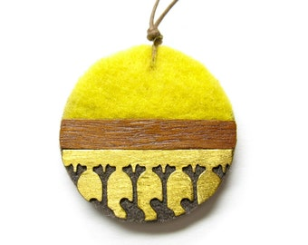 Necklace with YELLOW felt , wood and brass, round, Ginkgo cutout brass pendant