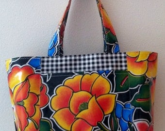 Beth's Large Black Tehuana flower power with exterior pockets Oilcloth Tote Bag