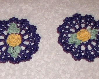 Two Crochet Cotton Doilies, Round, purple with a yellow rose, green leaves
