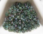 Miyuki 8/0 Round Seed Bead - Trans Olivine Picasso 4506 - approx 28 Grams