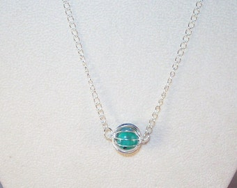 Genuine Turquoise Pebbles in Silver Cage
