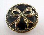 Victorian button brass bow black celluloid