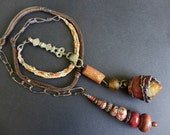 Dwale. Rustic tribal organic lariat in shades of brown and russet.
