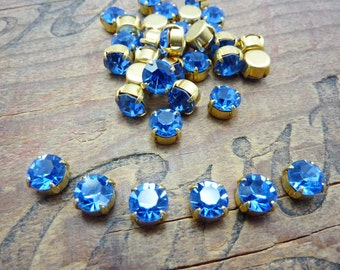 Vintage 7mm Glass Rhinestone in Brass Cup Sapphire (6) ER1327