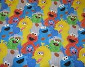 Sesame street. Elmo,cookie monster,bert,ernie. Sold by the half yard.