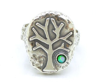 Tree ring with an opal, Sterling silver hammered band