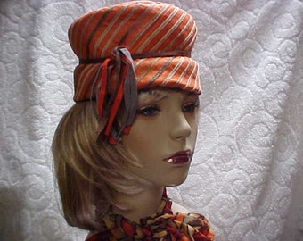 """Designer """"Lilly Dache'"""" pill box hat in orange stripe - and fringed ribbon band fits 21-22 inches"""