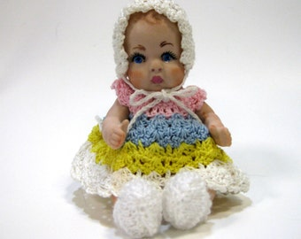 Handcrafted Porcelain Doll Five Inch Baby Girl in Crocheted Rainbow  Colored Dress