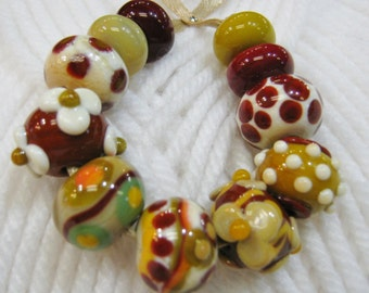 Handmade Lampwork Beads in Earth Tone Colors of Chestnut, Stone Ground, Ivory, Pea  Green and Relish.