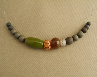 Necklace with handmade glass, ceramic and porcelain beads in green brown rust colors