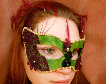 Green Leather Base Mask with purple lace and feathers and gold trim mardi gras colors
