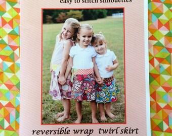 Wholesale Patterns-Quantity 5 -lovejill reversible wrap skirt pattern for little girls sizes 2 - 5