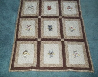 Handmade Baby quilt featuring embroidered puppies hanging on  ropes