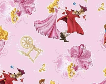 Disneys  Sleeping Beauty on Pink Cotton Fabric  Springs Creative Fabrics