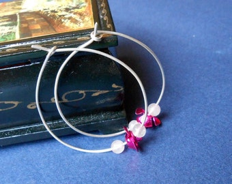 Silver hoops with flowers and rose quartz