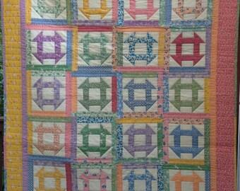 Cheerful 1930's reproduction Churn Dash crib quilt
