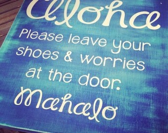 Aloha please leaves your shoes and worries
