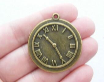 1 Clock charms antique bronze tone BC10
