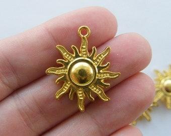 4 Sun charms bright gold tone GC1