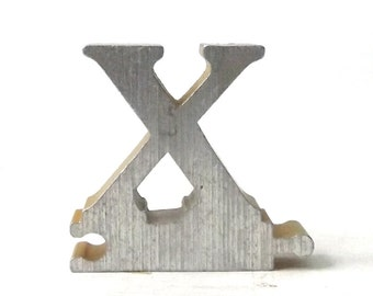 vintage 1950's letter X puzzle piece brushed aluminum metal word home decor sign message text type font silver retro home decor small old