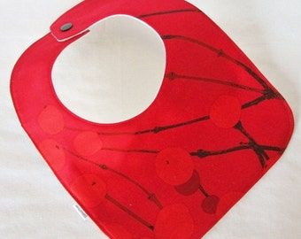 Red Marimekko bib  in Lumimarja, authentic Marimekko fabric from Finland